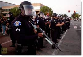outside agitators in the above photograph a garden grove police officer notice the patch on his right shoulder joins along with dozens of cops called