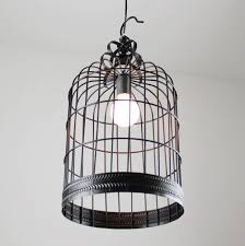 1 Find the centre point on the top of your birdcage and drill a hole for  the cord to pass through, using a drill bit that's about the same diameter  as the ...