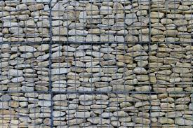 this massive wall features a wire mesh that holds all the stones together this concept is easily customizable in shape size thickness and color of both