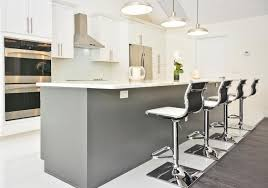 Modern kitchen design white cabinets Black Appliance Modern White Cabinet Kitchen With Gray Island And Metal Bar Stools Nytexas 45 Luxurious Kitchens With White Cabinets ultimate Guide