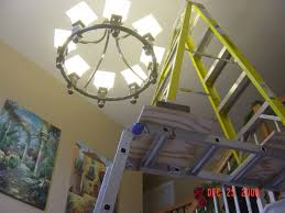 replacing chandelier entry is 2 stories tall phone painting with how to change chandelier