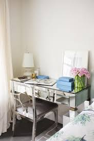 square mirrored teenage desk with mirrored desk chair and white desk lamp also white wall in