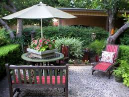 wood patio ideas on a budget. Stone Cheap Patio Floor Ideas With Wooden Chairs Decorative Plant On Round Table Under Umbrella Wood A Budget