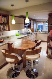 Wooden Round Breakfast Bar Situating Under Lime Green Modern Pendants With  Wooden Back White Stools Surrounds: Modern Kitchen Design Completed With  Stunning ...