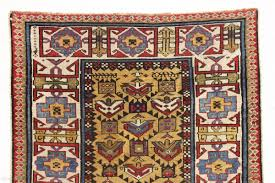 antique mustard yellow ground caucasian rug in good condition serrated lattice with large tulip palmettes