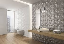 the metallic tiles on one of these bathroom walls give the bathroom a glamorous feel while the white 3d tiles add a more subtle texture to the walls