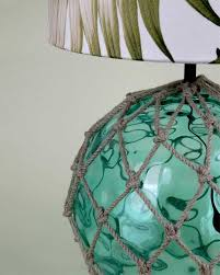glass fish float table lamp with tropical leaf lampshade green