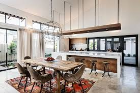 view in gallery vintage patchwork rug for the dining space in open plan living area design jo