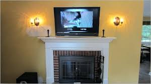 tv above fireplace wires great mount over fireplace decor ideas above mounting black and red b