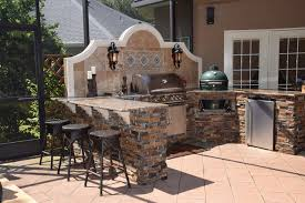 outdoor kitchen with big green egg gas grill and bar seating transitional patio jacksonville