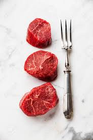 filet mignon raw. Interesting Raw Raw Fresh Marbled Meat Steak Filet Mignon And Fork On White Marble  Background Stock Photo Intended Filet Mignon
