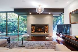 wood burning fireplaces are labour intensive and not particularly efficient most of the heat