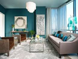 a teal accent wall aqua blue accessories and brown upholstered furniture