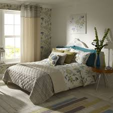 interior tropical leaf pattern bedding sets with grey blanket on white wooden bed combined by