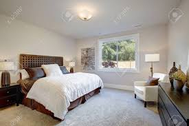 King size wood headboard Captivating Light Filled Bedroom Boasts King Size Bed With Wood Headboard Dressed In Brown And White Hdvotepeopleshsinfo Light Filled Bedroom Boasts King Size Bed With Wood Headboard