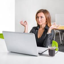 meditation office. business woman meditating near laptop relaxed office worker doing yoga meditation during a coffee break green eco healthy t