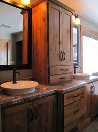 fascinating double white porcelain rounded sink feat bronze antique faucet rustic bathroom vanities on marble top as well as barn wooden drawers panels also