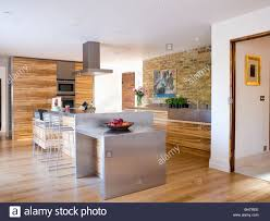 Kitchen Floor Units Stainless Steel Island Unit In Large Modern Kitchen With Wood