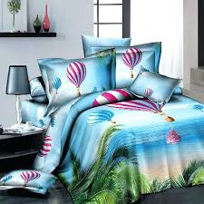 sky blue and green ocean beach themed tropical hawaiian island print holiday palm tree pattern full montegobeach themed crib bedding