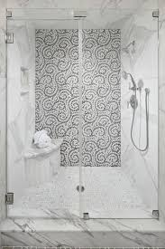 gray mosaic tiles on shower accent wall