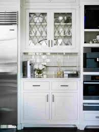 white kitchen with glass upper cabinets