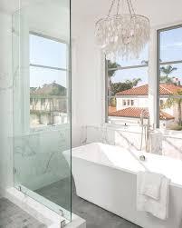 white capiz chandelier above rectangular tub