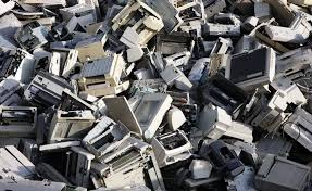 the importance of electronics recycling and e waste electronic scrap sorted used computer parts and printers at a recycling yard