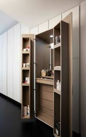 space in the bedroom and keeping the clutter of your makeup table away from sight consider building cubby holes on the flipsides of the wardrobe doors