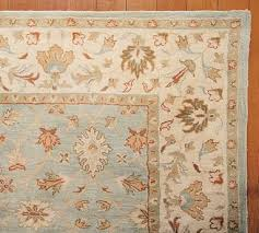 malika persian style rug 149 00 1 149 00 at potterybarn com the cool blues and tans in this wool rug will soften your space and add a touch of