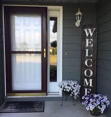 oversized front door front patio rustic wele pallet sign