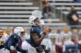 Akron Zips quarterback Kato Nelson fields a high shotgun snap during...  News Photo - Getty Images