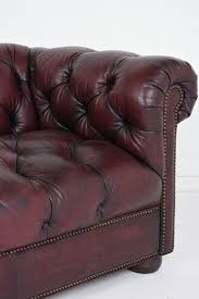 vintage chesterfield style tufted leather sofa