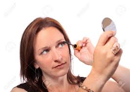 woman holding hand mirror. Woman Holding Hand Mirror Applies Mascara To Eyelashes Stock Photo - 7837521