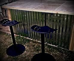 pool bar furniture. old metal table convert to outside patio bar added tin for sides tiled top and trimmed in cedar stools made from tractor seats perfect finish pool furniture