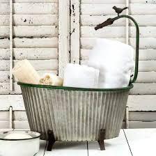 galvanized metal planter with garden hose bathtub vintage style