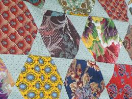 Material Obsession: Creative Women & Interesting to note is that over the years Brigitte has introduced lots of  interesting ways to finish off quilts and this is one example. Adamdwight.com