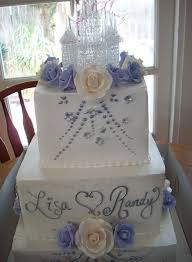 Big Two Tiers Engagement Cake With Floral Cake Decor And Glass
