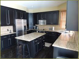 sweet black ceramic flooring tile and black wooden bar stool combined with dark oak wood kitchen cabinets