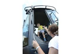 Sarasota County hosts 19th Annual Big Truck Day EGGstravaganza - Colton  Barnett, 2, gets help out of a tractor from Polly Barnett, his grandmother.  Polly said he loves big trucks–he had on