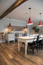 dining crafts room with red pendant lights