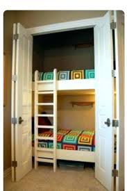bed with closet underneath bunk hide out for the kids in a converted bedroom loft ideas