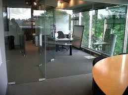 installed new glass partitioning systems with swinging glass doors for a popular luxury hair s office