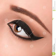 glamour black eye make up with wide arrow macro studio shot sharp on the eyelashes and arrows makeup for evening or holiday