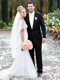 gene simmons wife wedding dress. molly married scott in a simple yet elegant wedding on vineyard napa wearing flowing white marchesa gown. she carried bouquet of peach gene simmons wife dress k