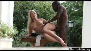 Beautiful young blonde interracial fucked in the backyard.