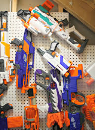Space out 2 pegs at approximately the same length as the nerf gun and hang the gun over the pegs. Easy Diy Nerf Gun Storage Thrifty Decor Chick