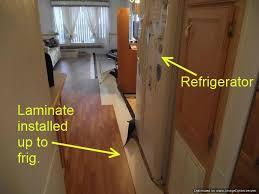installing laminate flooring under refrigerators saveenlarge how to install laminate flooring under kitchen cabinets