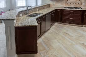 kitchen tile flooring. Fine Tile The Beige Granite Tile Floor Pairs Well With The Brown Flecked Countertops  In This Kitchen Inside Kitchen Tile Flooring E