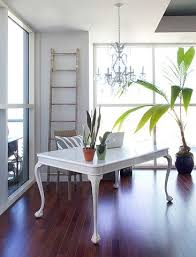 hanging a chandelier over the desk is a great way to define a home office that s