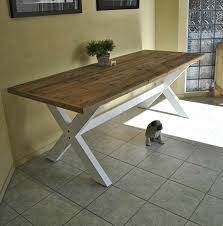 old farmhouse kitchen table with reclaimed wooden top and cross x legs painted with white color decor ideas